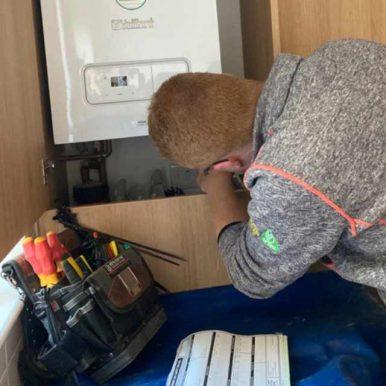 Gas engineer repairing a boiler